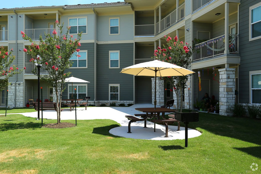 Exterior view of The Villages at Ben White with seating area