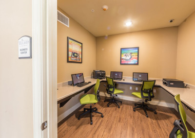 Tech Center at the Villages at Ben White with multiple computers and green chairs