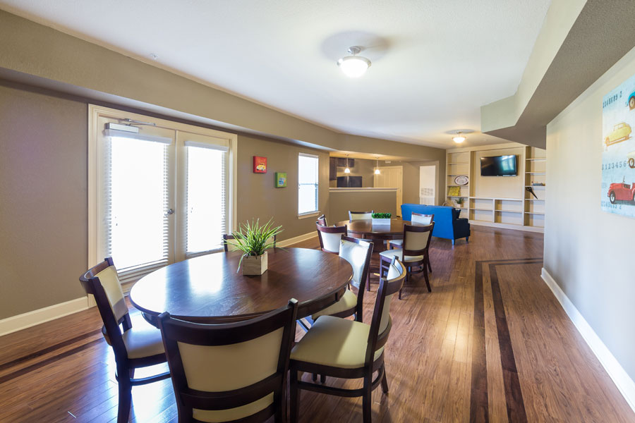 Community room at the Villages at Ben White with wooden tables
