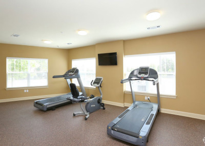 Fitness center at our Austin retirement community with two treadmills and a stationary bike