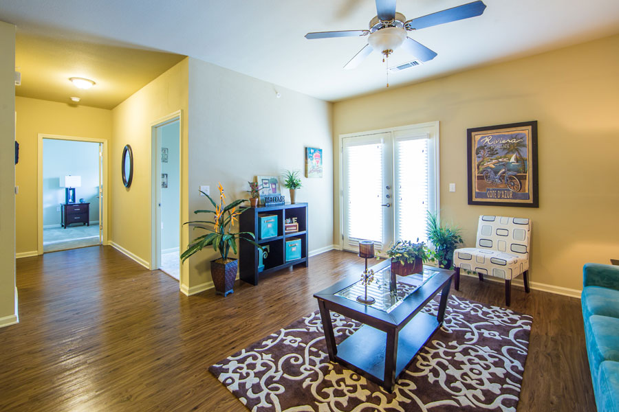 Living room at the Villages at Ben White showing access to the private patio
