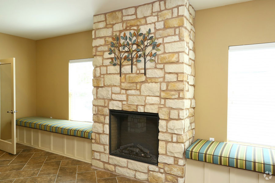 Stone fireplace at the Villages at Ben White lobby