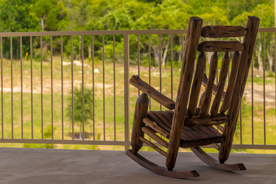 Patio area at The Villages at Ben White with wooden rocking chair