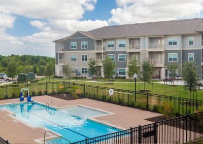 Exterior view of The Villages at Ben White with gated outdoor pool