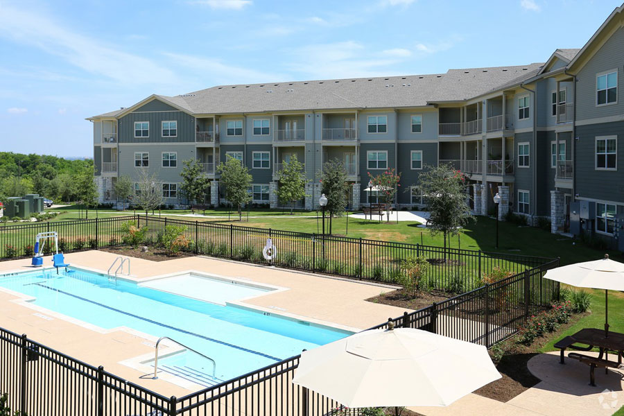 View of the pool area at the Villages at Ben White from a balcony
