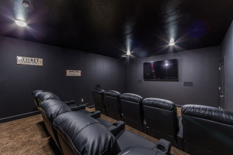Villages at Ben White theater room with a large television and leather movie theater style chairs