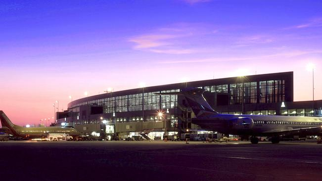 Airplanes and exterior view of a terminal